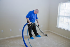 Man cleaning carpet with commercial cleaning equipment in st marys county maryland